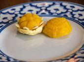 stock photo of yolk  - Wheat flour dumplings with egg yolk and sugar traditional Thai sweetmeat on plate - JPG