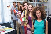 foto of students classroom  - Happy students waving international flags at the college - JPG