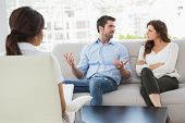 stock photo of therapist  - Couple talking with their therapist in the office - JPG