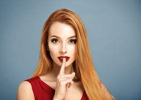 pic of hush  - Beauty Portrait of Sexy Woman with Finger on her Red Lips Showing Hush - JPG