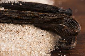 picture of vanilla  - vanilla sugar and vanilla beans on wooden table - JPG