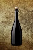 foto of sparkling wine  - bottle of sparkling wine on background with effects - JPG