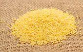 pic of millet  - Heap of yellow millet groats lying on jute canvas healthy food healthy nutrition - JPG