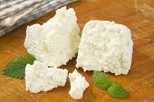 picture of curd  - slices of fresh curd cheese on wooden cutting board - JPG