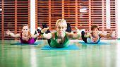 stock photo of locusts  - Girls practicing yoga - JPG