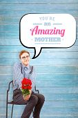 stock photo of bunch roses  - Geeky hipster holding a bunch of roses against wooden planks background - JPG