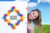 picture of aspergers  - Woman holding poster against field and sky - JPG