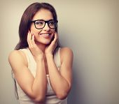 stock photo of happy-face  - Happy laughing young casual woman holding hands the face - JPG