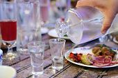 pic of vodka  - Waiter filling vodka in the russian restaurant - JPG