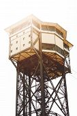 stock photo of ropeway  - Metal designs inside of a tower of a ropeway in Barcelona against the sky - JPG