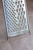 picture of paper craft  - Retro stainless steel grater on paper craft background - JPG