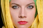 stock photo of burqa  - Serious woman wearing colourful headscarf - JPG