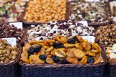 foto of dry fruit  - Nuts and almonds and dried fruits for sale at the market - JPG