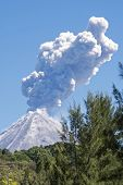 foto of volcanic  - Colima volcano or Volcan de Fuego with ash and steam eruption Colima Mexico - JPG