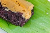 picture of custard  - Black Sticky rice with custard wrapped in banana leaves - JPG