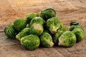 image of brussels sprouts  - few Brussels sprouts on old wooden table - JPG