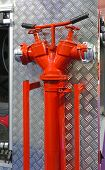 stock photo of fire truck  - Water Hydrant Pipe With Valves at Fire Truck - JPG