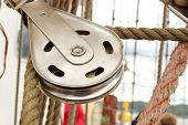 image of  rig  - Closeup of old metal block and rigging at the yacht - JPG