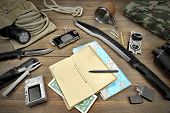 stock photo of torches  - Rough Wood Desktop With Objects For Travel Expedition Exploration Or Hike - JPG