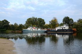 stock photo of sand lilies  - Old ships on the small river Gomel Belarus - JPG