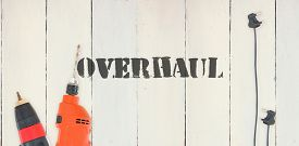 picture of overhauling  - The word overhaul against diy tools on wooden background - JPG