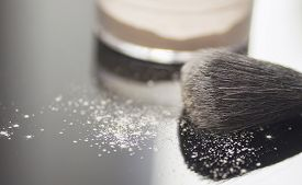 stock photo of face-powder  - Closeup image of a face powder with a face brush - JPG