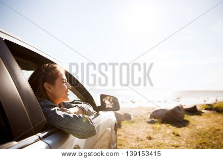 summer vacation, holidays, travel, road trip and people concept - happy smiling teenage girl or youn