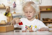 picture of montessori school  - Young Girl Playing at Montessori - JPG