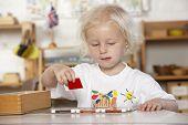 foto of montessori school  - Young Girl Playing at Montessori - JPG