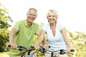 image of portrait middle-aged man  - Mature couple riding bikes - JPG