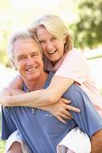 picture of old couple  - Portrait Of Romantic Senior Couple In Park - JPG