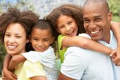 picture of mixed race  - Portrait of Happy Family In Park - JPG