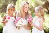 stock photo of flower girl  - Bride With Bridesmaids Outdoors At Wedding - JPG