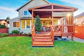 Back Yard House Exterior With Wooden Walkout Deck And Porch poster