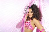 picture of belly-dance  - Belly of the woman dancing in the pink dancing dress - JPG