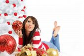 stock photo of xmas tree  - young woman with gift box next to white christmas tree - JPG