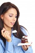 Businesswoman wearing blue shirt eating the cake.