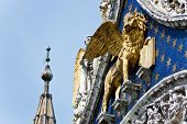 stock photo of porphyry  - The Venetian lion on a cathedral building on San Marco square - JPG