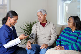 foto of health-care  - Home health care worker and an elderly couple - JPG