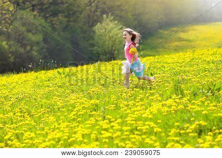 Kids Play In Yellow Dandelion Field  Child Picking Summer Flowers  Little  Girl Running In Spring Dan poster