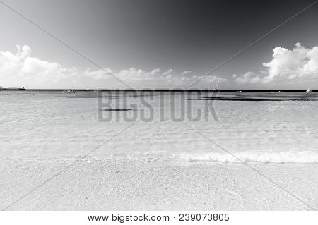 poster of Sea. Beautiful White Clouds On Blue Sky Over Calm Sea With Sunlight Reflection, Bali . Tranquil Sea