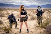 In A Post-apocalyptic Desert Wasteland, A Queen Of The Apocalypse Leads Her Militia Against The Enem poster