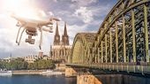 multicopter drone flying next to the Hohenzollern Bridge across the rhine river, Cologne Cathedral i poster