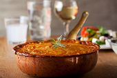 image of ouzo  - baked moussaka dish on a wooden board - JPG