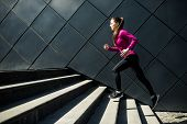 Athletic Woman Running Up Stairs During Cardio poster