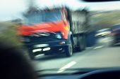 Truck With Red Cab On The Road In Motion. Accident Rate. View From The Cab Of The Car poster