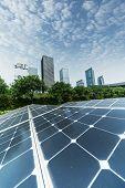 solar panel plant with urban landscape landmarks,Ecological energy renewable concept. poster