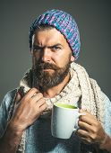 Portrait Bearded Man Drinking Hot Beverage On Cold Winter Day. Cold Season - Warm Beverage. Man Warm poster