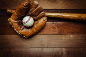 A Group Of Vintage Baseball Equipment, Bats, Gloves, Baseballs On Wooden Background poster