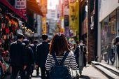 Постер, плакат: Young Asian Woman Traveler Traveling And Shopping In Myeongdong Street Market At Seoul South Korea